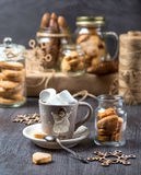Cup of cocoa on a gray background. Cookies in glass jars Stock Photography