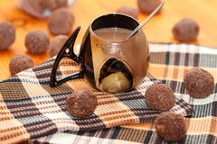 Cup with cocoa. Cup of hot cocoa on a checkered napkin with balls of the pressed cocoa Stock Photography