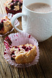 Cup cocoa with milk and homemade black berry muffins Stock Photography