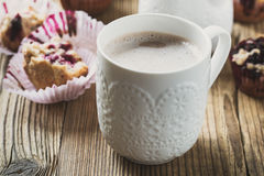 Cup cocoa with milk and homemade black berry muffins Stock Images