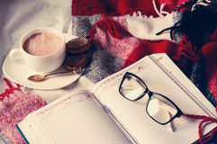 Cup of cocoa staying on open book Stock Images