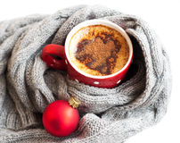 Cup of cocoa wrapped in grey scarf Royalty Free Stock Photos