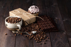 Cup of cofe beans and beans on wooden table Stock Image