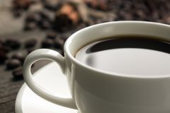 Cup of cofee. With cofee beans on background stock images
