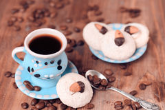 Cup of cofee with cookies. Almond homemade cookies with cup of coffee, selective focus Stock Photos