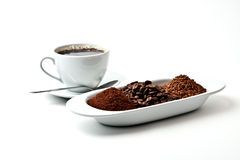Cup of cofee with fresh coffee on plate Royalty Free Stock Photos