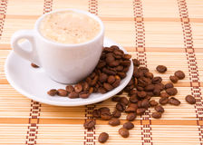 Cup of cofee and  grains Royalty Free Stock Image