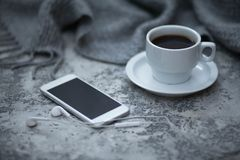 Cofee and mobile phone. Cup of cofee and mobile phone royalty free stock photos