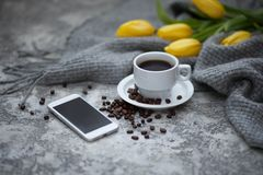 Cofee and mobile phone. Cup of cofee and mobile phone Royalty Free Stock Photo