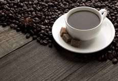 Cup of cofee with sugar and cofee beans. Cup of cofee  with sugar and cofee beans on the table Stock Photos
