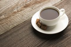 Cup of cofee with sugar. On the table royalty free stock image