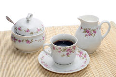 Cup of cofee with two objects. On the mat Stock Photo
