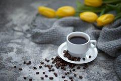 Cofee and yellow tulips. Cup of cofee and yellow tulips Stock Photography