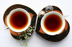 A Cup of coffe. Coffee pair. Grains of coffee. Over white Stock Image