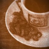Cup of coffe. Cup of espresso coffe and grains on a vintage grunge background royalty free stock photography