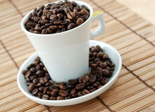Cup with coffe beans royalty free stock images