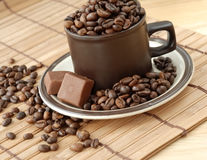 Cup with coffe beans Royalty Free Stock Image