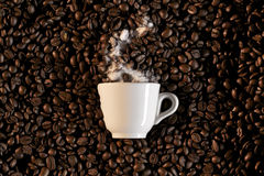 A cup and coffe beans - caffe espresso Stock Photography