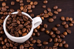 Cup of coffe beans Royalty Free Stock Images