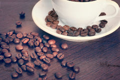 Cup of coffe beans on a table Stock Photo
