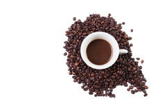 Cup in coffe beans Stock Photo
