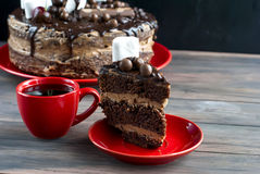 Cup coffe and Big chocolate cake with chocolate frosting and che Stock Photo