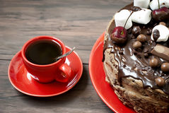 Cup coffe and Big chocolate cake with chocolate frosting and che Stock Photography