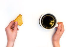 Cup of coffe with biscuit in hands Stock Photos
