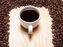 A cup of coffe on breadboard Royalty Free Stock Images