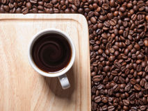 A cup of coffe on breadboard Stock Photos