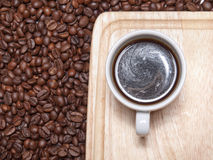 A cup of coffe on breadboard Stock Images