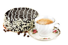 Cup of Coffe and Cake. Cup of coffe with a cake in the background stock photography