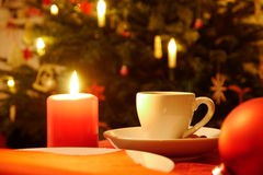 Cup of coffe and candle Stock Photos