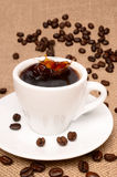 Cup of coffe. E as background close-up Stock Photo