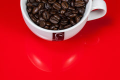 Cup of Coffe with Coffee Beans Stock Images