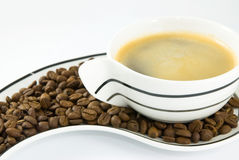 Cup of coffe and coffee grains Stock Photo