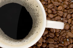 Cup of coffe and coffee grains Royalty Free Stock Photos