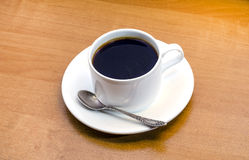 Cup of coffe. E on a wooden table Stock Photo