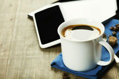 Cup of coffe with Digital tablet computer and smart phone Royalty Free Stock Photos