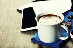 Cup of coffe with Digital tablet computer and smart phone Stock Photos