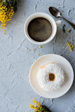 Cup of coffe and a donut on concrete background Royalty Free Stock Photo