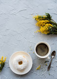 Cup of coffe and a donut on concrete background Royalty Free Stock Photography
