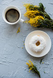 Cup of coffe and a donut on concrete background Royalty Free Stock Image
