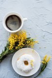 Cup of coffe and a donut on concrete background Royalty Free Stock Photos