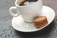 Cup of coffe with french  macaron Stock Images