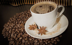 Cup and coffe grains Stock Images