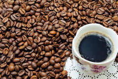 Cup of coffe and grains Royalty Free Stock Image