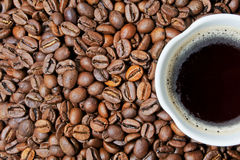 Cup of coffe and grains Stock Photography