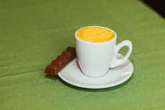 Cup of coffe. Cup with coffe on green table Royalty Free Stock Images