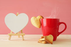 Cup of coffe and heart shape cookies Stock Photography
